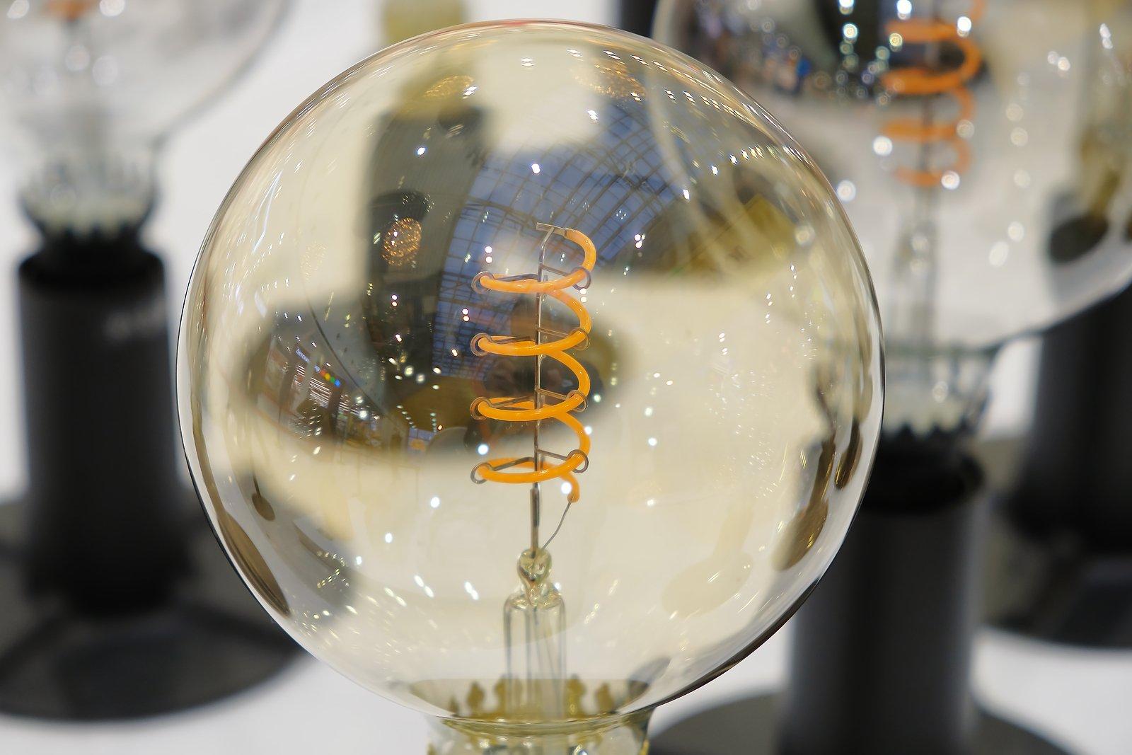 bigstock-Retro-Light-Bulb-On-The-Backgr-401835365