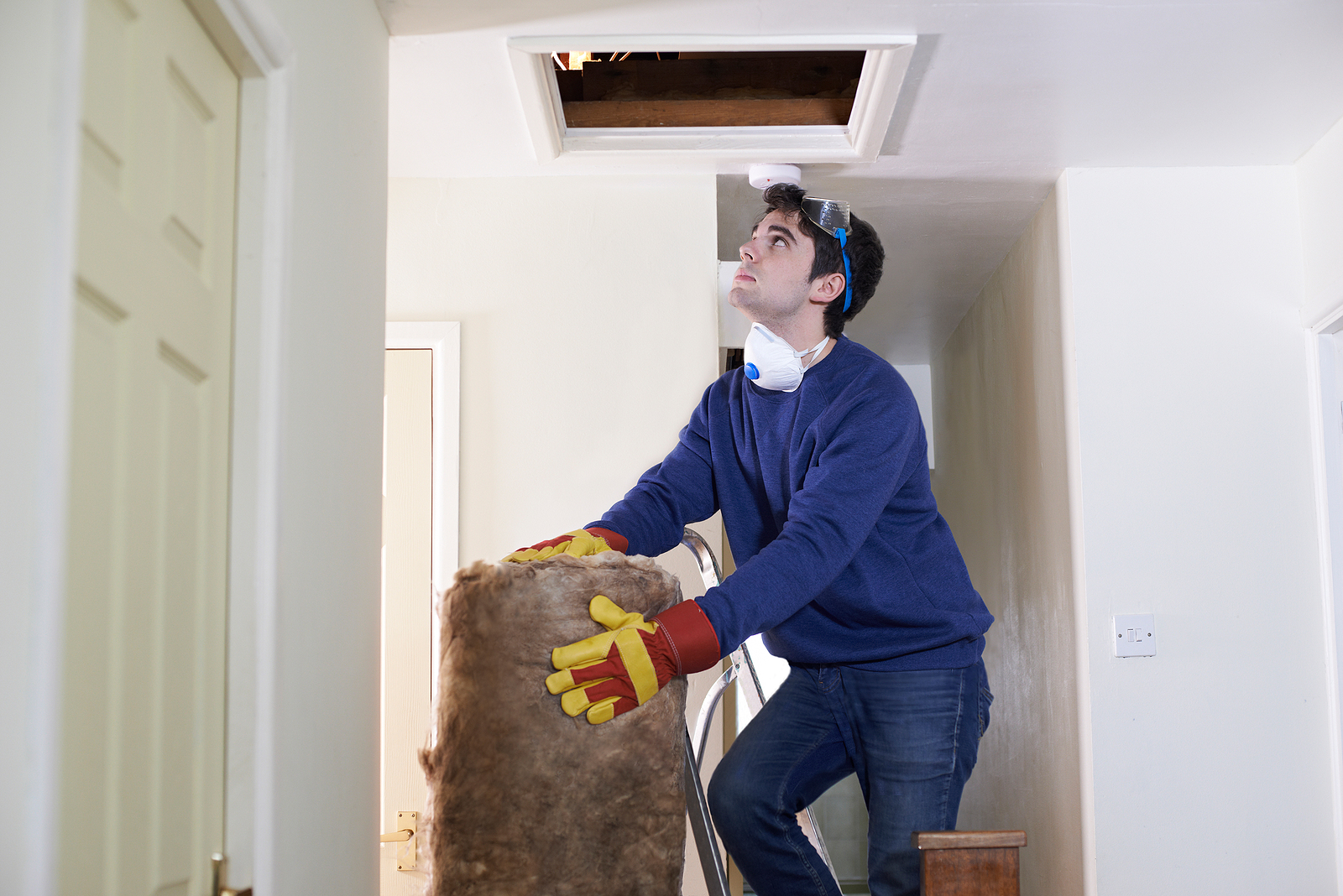 man-climbing-to-attic-with-insulation-wilcox-electric-dc